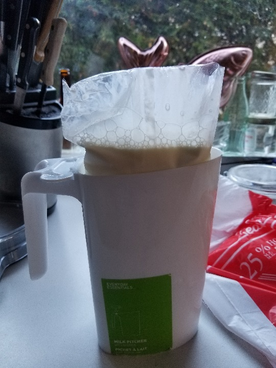 milk bag in the pitcher, snipped and ready to go